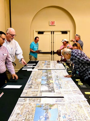Members of the public inspect plans for improving the roads in Daytona Beach's core beachside.