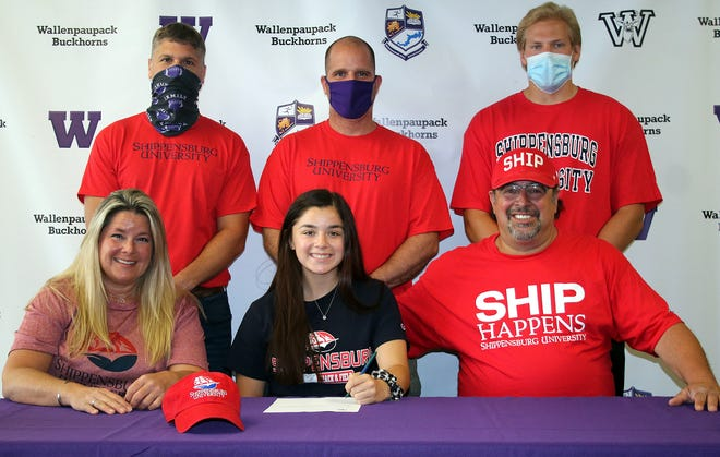 Flanked by her mom Allie Brock and dad Mike Mancino, Wallenpaupack alumna Katie Mancino recently signed her Letter of Intent to continue her academic and athletic careers at Shippensburg University. Also joining her to commemorate the moment were Wallenpaupack Area track & field Assistant Coach Dave Miller, Head Coach Mark McHugh, and Assistant Coach Matt Nawrocki.