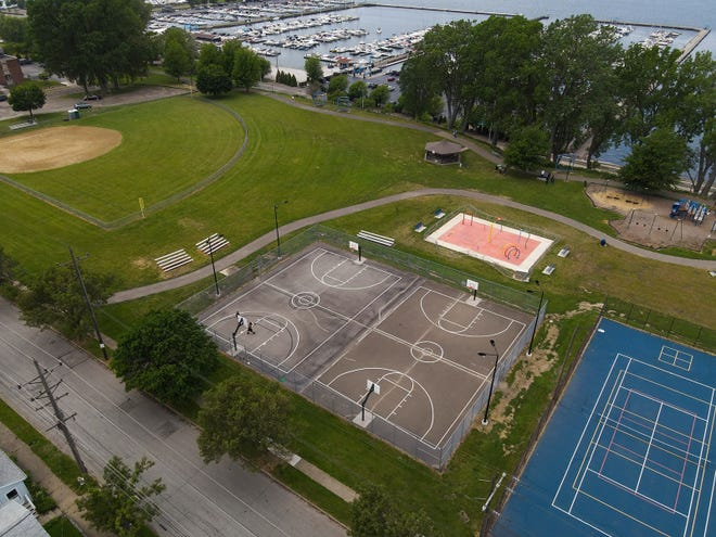 This is an aerial photo of Bayview Park in Erie's west bayfront neighborhood. Florida-based artist Mwanel Pierre-Louis will design a mural for the courts, which will be painted in September.