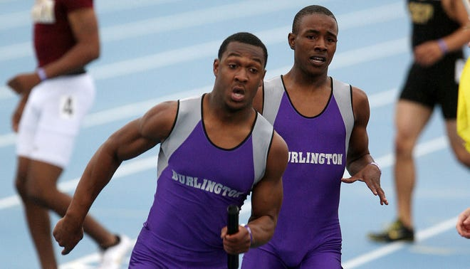 Burlington's Josh Osborn, front, and Demarcus Chew, back, overcome a near miss the first handoff to win the Class 4A 4x200 relay Friday May 21, 2010 at the State Track Meet in Des Moines, Iowa.  Jordan Webb and Jamal Simmons ran the third and fourth legs.