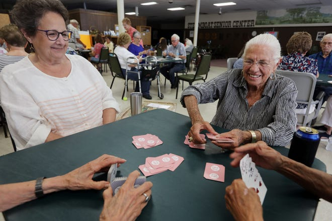 Deanne LIndholm deals cards as Dawn Boche, left, looks on July 19 while the two play bridge at the Steamboat Senior Center in downtown Burlington. Heart Song Inc. has offered the Steamboat Senior Center a new home at its future location at 2610 S. Fifth St., where it also plans to open an adult day center for seniors who are unable to stay home alone due to acquired neurological and physical disorders. Should the center move into Heart Song, it would not have to pay rent or utilities.