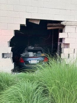 A car crashed into the Town Fair Tire building in Rochester on Saturday.