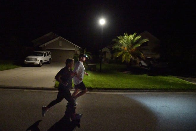 At 4:30 a.m. Monday, Army veteran Andrew Coughlan and his wife Ashley start the first of 17 one-mile runs through their St. Augustine neighborhood. Seventeen years ago Coughlan escaped death while serving in Iraq during a mortar attack that killed two members of his team. He ran to honor their memory and raise money for veterans through the Wounded Warrior Project.