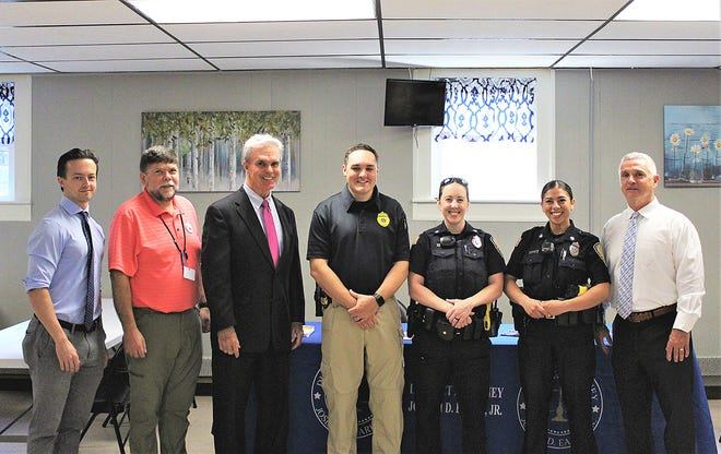 Worcester County District Attorney Joseph Early recently visited the Gardner Senior Center to discuss scams that target the elderly. Pictured from left are: Colin Smith, executive director for Mayor Michael Nicholson's office; Michael Ellis, senior citizens director for the Gardner Council on Aging; Early; Lt. Nicholas Maroni; Officer Danielle Dorval; Officer Alex Laderoute; and Kevin Donohue, senior outreach official with the district attorney's office.
