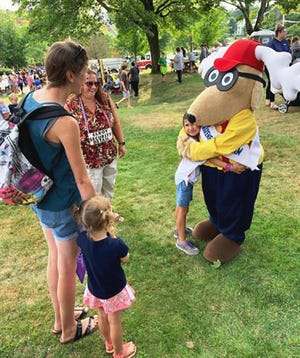 Elks Club mascot Elroy receives a hug during the 2019 National Night Out event at Monument Park in Gardner.