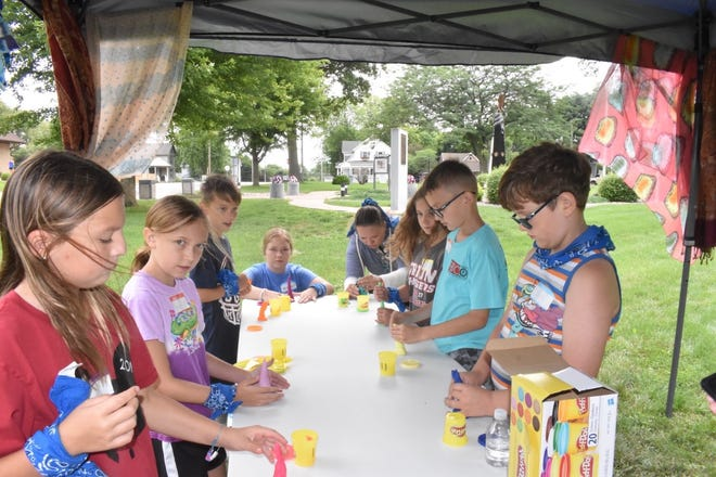 """First Baptist Church of Orion held its session of Vacation Bible School, """"Character Check,"""" on Tuesday, July 13, in Central Park. These children have been learning about Tabitha, a woman in the New Testament known for her humility. She provided clothes for the poor and widows without seeking recognition."""