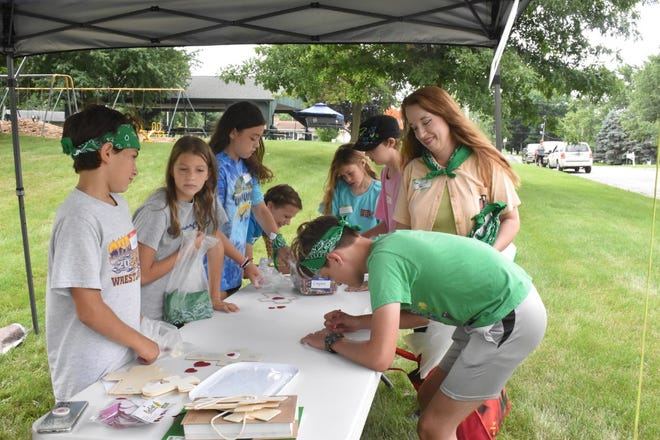 """Children make a craft as they learn about a Bible story during First Baptist Church's """"Character Check"""" Vacation Bible School on Tuesday, July 13, in Central Park, Orion. The story was about the forgiveness Joseph gave his brothers, who had sold him into slavery in Egypt"""