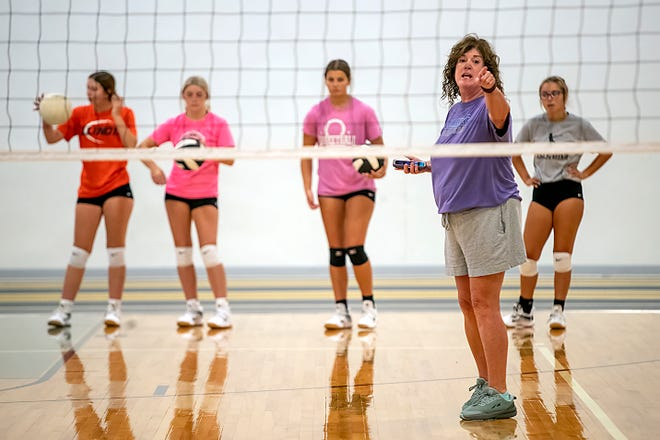 Galesburg High School volleyball coach Marla Clay gives instructions to her players during a drill at summer camp on Monday, July 19, 2021 at the GHS fieldhouse.