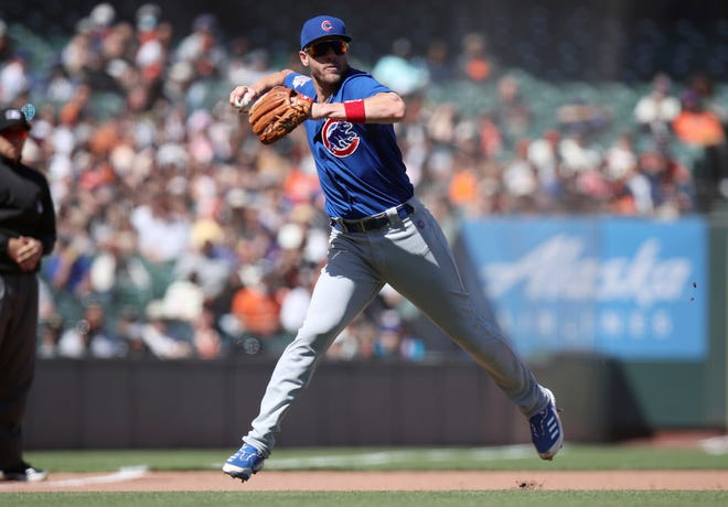 Chicago Cubs third baseman Patrick Wisdom fields a ground ball and throws out San Francisco Giants' Mike Tauchman to end the eighth inning of a game Sunday, June 6, 2021, in San Francisco.