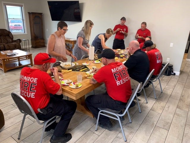 Slices of three pies are served to the firefighters with the Van Buren Fire Department who were judges.