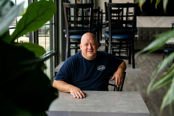 Greg Bone, the owner of Bone's in Keller Station, poses for a portrait in his restaurant on Monday, July 19, 2021. Bone opened during the pandemic and has worked 20 hour days in order to keep the restaurant afloat.