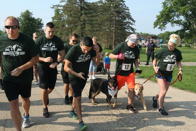 Dustin Jarrard, second from right, steps off with his father's dog Mika, at the Dennis Jarrard Memorial Run held Saturday, July 17, 2021, at Taylor Park in Freeport. Dennis Jarrard, a local pastor and chaplain with the Freeport Police Department died in May.