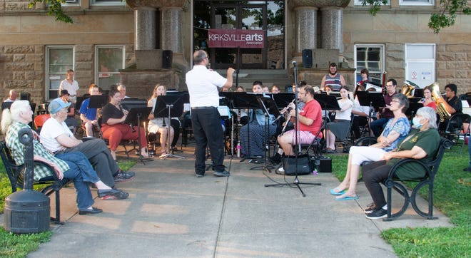 The Kirksville Community Band performs in front of the Adair County Courthouse on July 16 as part of the Summer on the Square Concert Series.