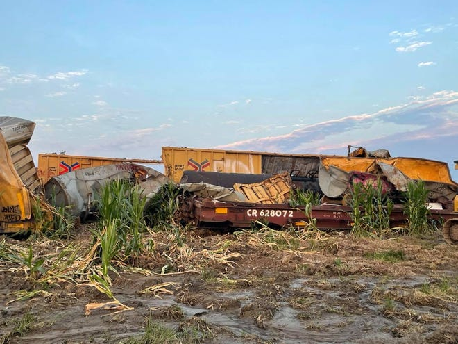"""rain wreckage nows sits in a field along Landau Road as crews work to clean up debris from the July 9 train derailment north of the Marceline City limits. Marceline Fire Chief and Mayor Jeri Holt said that work will continue """"for some time."""""""