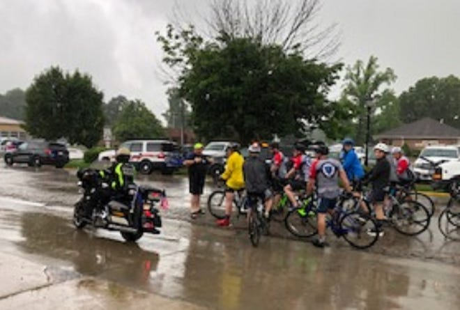 Members of Eminence Christian Church fed the bicycle riders from the Illinois Concerns of Police Survivors group that traveled through Logan County on Friday. C.O.P.S. stoped at the Atlanta Fire Department where they were treated to lunch by Eminence Christian Church in rural Atlanta.  Riders started their trip July 15 from Alton riding through Central Illinois arriving in Chicago on July 18.  These riders are honoring those comrades lost in the line of duty as well as fundraising to support their families.