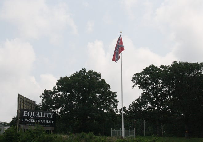 A Confederate flag has been flying for months along Highway 54 just outside of Eldon. One woman has leased a billboard in response.