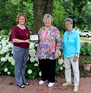 On June 29, 2021, WIRC & CAA Executive Director Tracy Camden (left) and WIRC Administrative Assistant Rose Elam (right) presented retiring CAA Board Member Nancy Jameson (center) with a plaque to recognize her 39 years of distinguished service to the Agency.