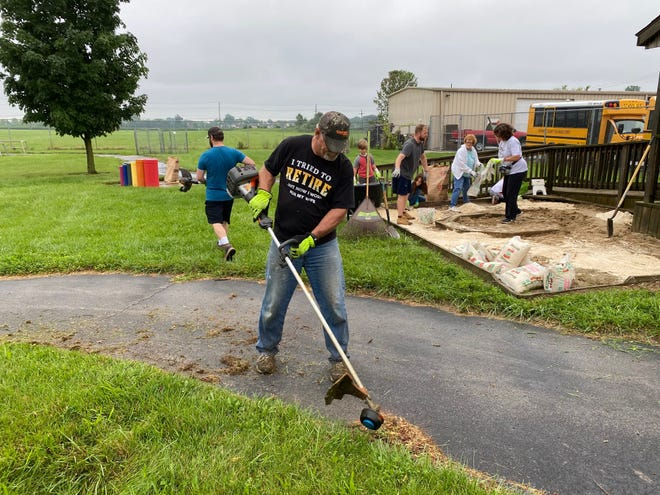 Volunteer Rick Smith edges the playground