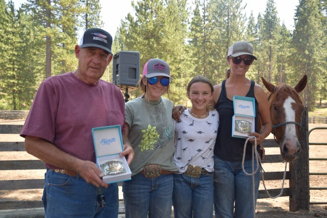 Belt Buckle winners of the 7th Annual Squaw Valley Riding Club Team Roping were heeler Gary Darst (left) and header Ashley Taylor (on right) with Danica Wagner and Cameryn Schweninger, who also rode.