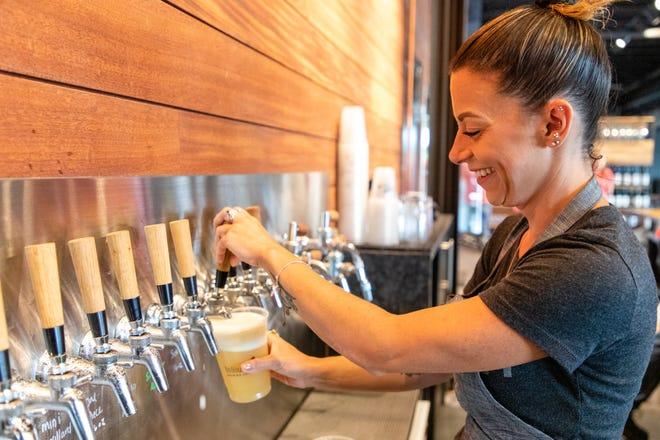 Aly Vito pours a Mini Mallard at the Trillium Brewing Co. taproom in Canton on July 15, 2021.