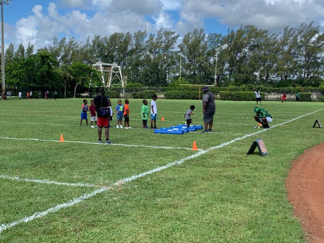 Youngsters take part in the first All Star Youth Sports Summer Slam Saturday in Riviera Beach where they learned the fundamentals about football from some locals with NFL pedigrees.
