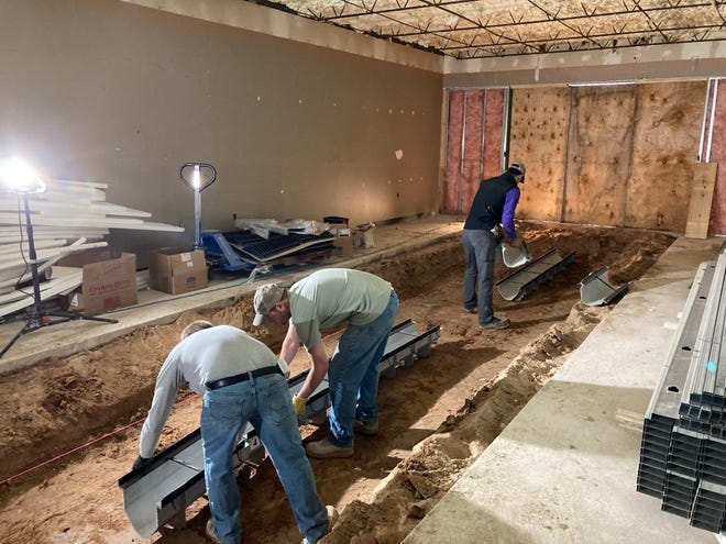 J.K. Knight Construction crew installing trench drain several months ago at the PRMC Urgent Care & Health Center (from left) include Christopher Prescott, Brad Richardson and Chase Galle.