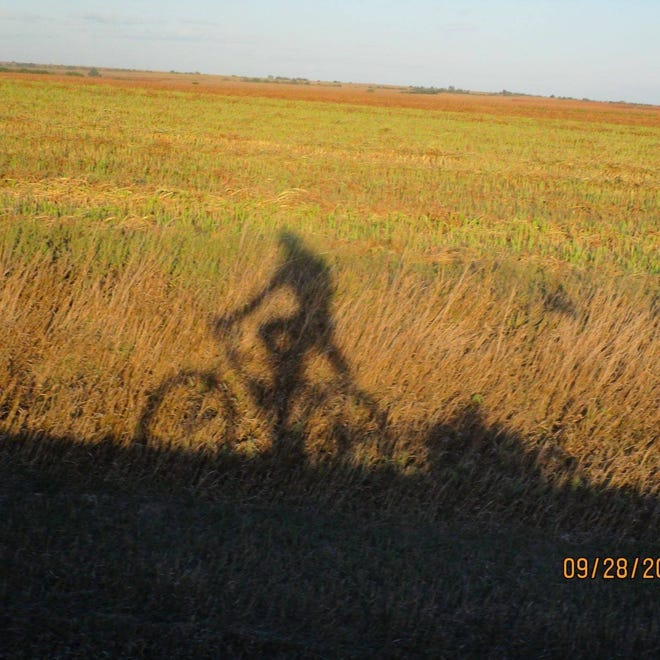 Bicycling has many benefits according to Brandon Case, Pratt, who took this shadow-selfie while riding recently.