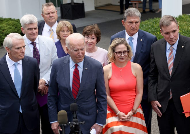 President Joe Biden speaks outside the White House late last month with a bipartisan group of senators after meeting on an infrastructure deal.
