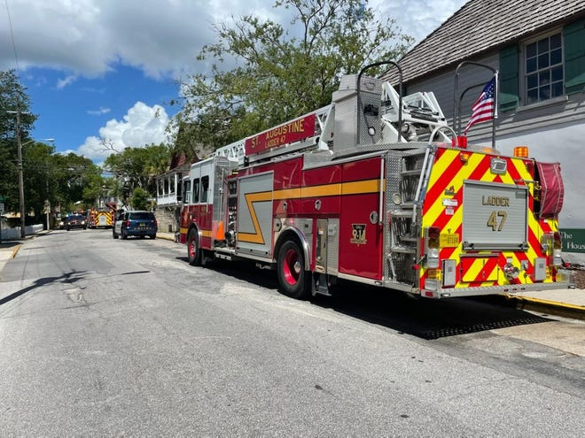 Firetrucks and police SUVs park on St. Francis Street in St. Augustine near a trolley wreck on Saturday.