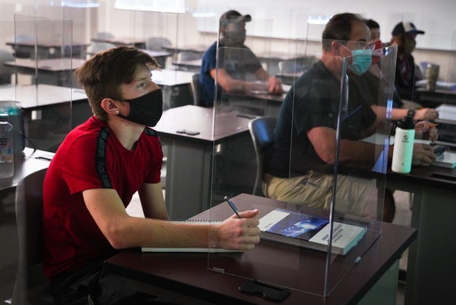 Austin Morris, left, attends an introduction to electronics class at State College of Florida in Bradenton on Monday. DANIEL WAGNER / HERALD-TRIBUNE