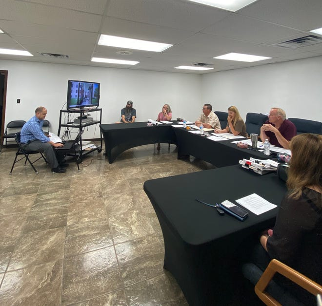 Pottawatomie County Commissioners listen to a presentation regarding elements of their new administration building. The county's new building will be constructed next to the courthouse in Shawnee.