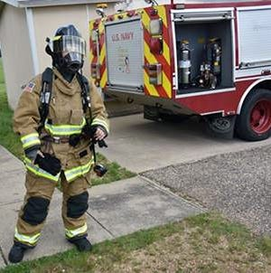 Aviation Boatswain's Mate 2ndClass Brooke Fox suits up in full gear to show how crash crew members respond to emergencies recently at Navy Air Station Whiting Field.