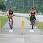 Ashley Morton (left) and Jordan Daywalt use the Cross City Trail to ride to Wrightsville Beach on June 18, 2010.