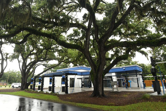 Caliber Car Wash off Market Street is tucked back among old oak trees that were preserved when building the site. Many locals have expressed concern about how to balance new development with tree preservation more broadly in the Cape Fear region.