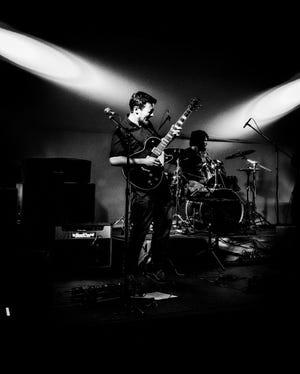 Singer and guitarist Adam Bastug leads Wilmington band Hot Plastic Poets.