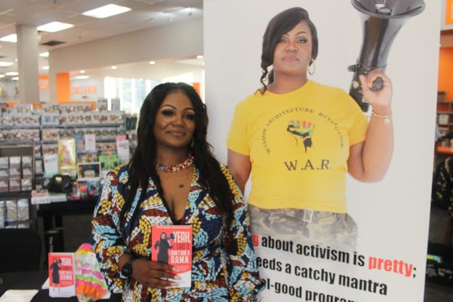 """Chanae Jackson is pictured here at the book signing for her newly released book titled """"Yeah, I said it, I don't give a D.A.M.N.,"""" which is a political activism text addressing disparities, allegiances, mindsets and """"N-words."""" The book signing was held Friday at 2nd & Charles, 2601 NW 13th St."""