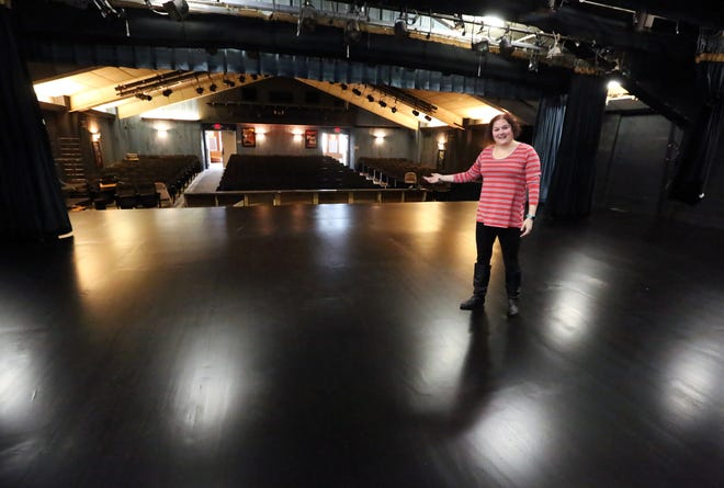 Kait Gallagher-Wilsterman, secretary of the board of trustees, shows off the new stage floor at Little Theatre in this file photo.