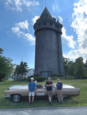 Nick Kessler stands in front of Lawson Tower with the team from the Scituate Historical Society.
