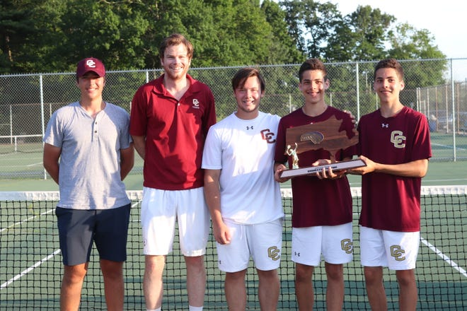 Pictured from left: Assistant Coach Bondick, head coach Alex Spence, senior captains Ben France, Amar and Avi Ruthen holding the title trophy.