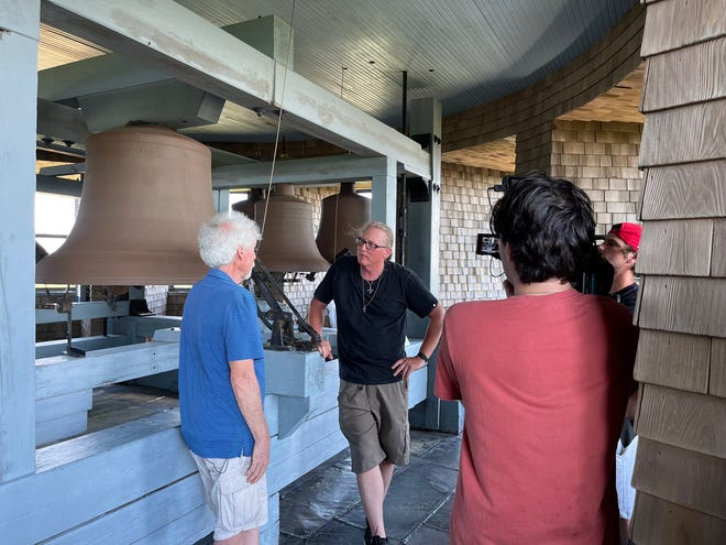 Nick Kessler chats with historian Robert Chessia at the top of Lawson Tower in Scituate.