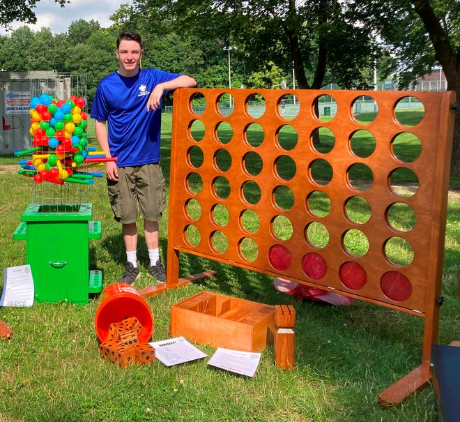Mansfield Scout Ryan Morley, left, recently donated games he built including this Kerplunk and Connect 4 to the Mansfield Parks and Recreation Department for its summer camp program at Memorial Park.