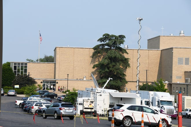 Trucks, including one with a television satellite dish and others bearing the name Game Creek Video, are parked on the campus of Mount St. Joseph University in Delhi Township outside of Cincinnati. Mt. St. Joseph is a Catholic university on the West Side of Cincinnati.