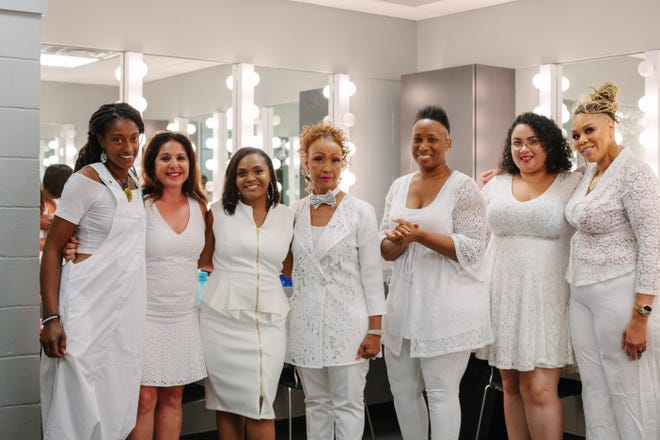 """Teresa Zilk poses with the six performers participating in 2019's """"Stories to Tell My Daughter"""" story telling event."""