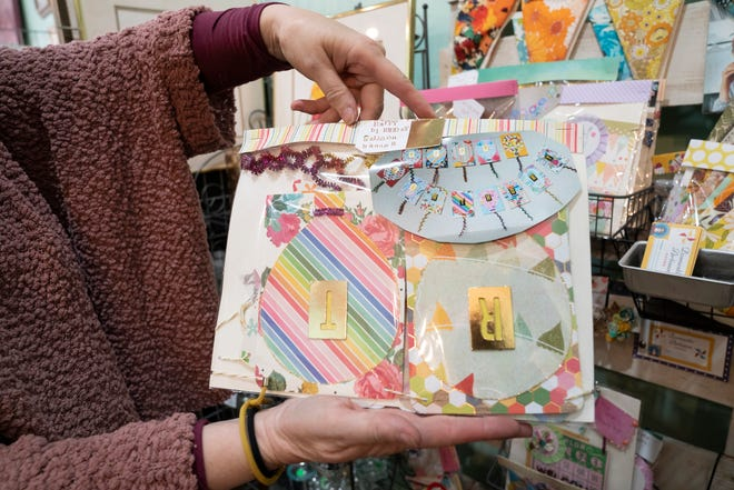A Detroit based business Leaf and Blossom sells artwork and crafts created by 22 Detroiters and features festive banners made by Christina Sean and are in store Wednesday, May 5, 2021. The store opened in December 2020 in response to art shows shutting down due to the pandemic. The store is co owned by Lillian Li, 62, of Grosse Pointe, Maggie Mazzara, 72, of Grosse Pointe Woods and Victoria Li, 26, of Detroit.