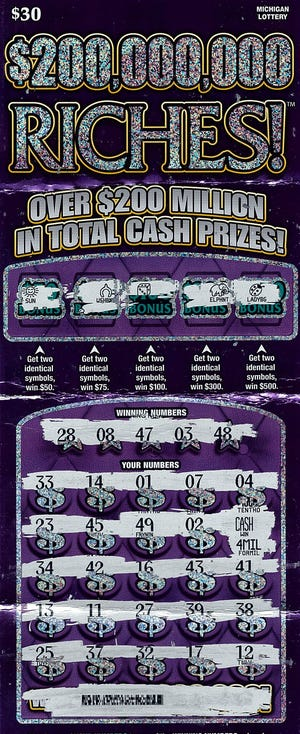 A Saginaw County woman won $4 million playing this $30 Michigan Lottery Riches instant ticket.