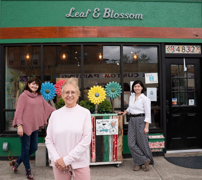 Leaf and Blossom co owners Lillian Li, 62, of Grosse Pointe, left, Maggie Massara, 72, of Grosse Pointe Woods and Victoria Li, 26, of Detroit stand out front of their Detroit store Wednesday, May, 5, 2021. The store opened in December of 2020 during the pandemic after art shows were being cancelled. The store supports local artists.