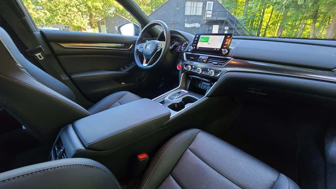 The interior of the 2021 Honda Accord Sport includes a tablet infotainment screen, comfy seats, and digital instrument display. All for just $33.5k.