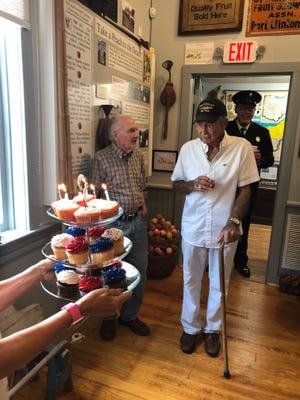 Don Rhodes celebrates his 90th birthday at the Catawba Island Historical Society Union Chapel Museum.