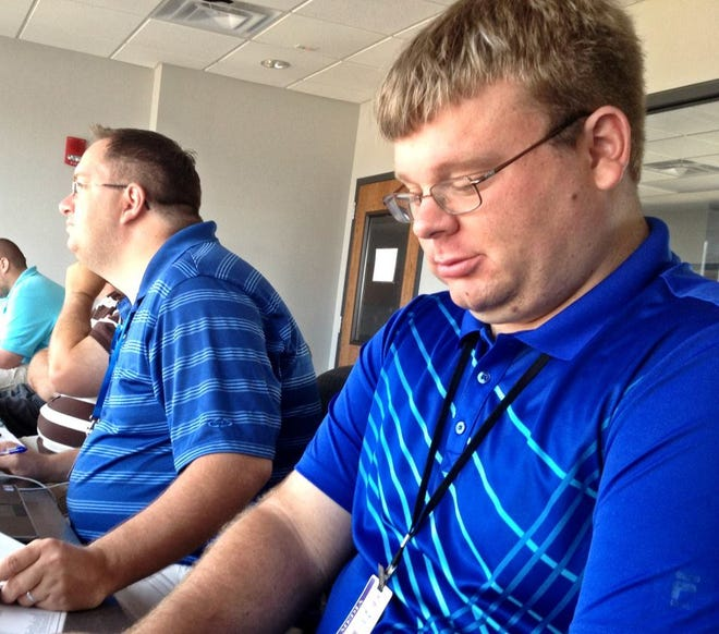 Michael Odom (right) wraps up 16 years covering sports for The Jackson Sun this week. He's seen here in the press box of the baseball stadium at Middle Tennessee State University covering Riverside in the Class A baseball championship in 2012.