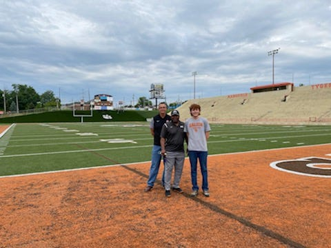 Former Cleveland Browns running back Greg Pruitt tours the renovations at Arlin Field with Mansfield City Schools Facilities Director Bob Booth (left) and his grandson, Bronson (right). Pruitt will be playing in the annual TYger Booster Club's TYger/Falcon Alumni Golf Outing next weekend.